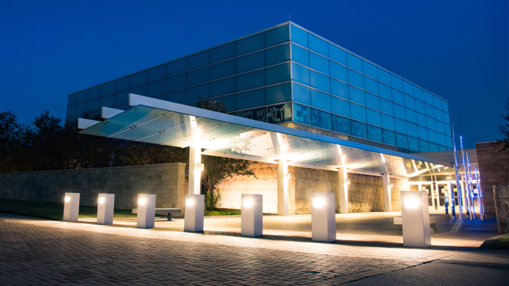 Nighttime photo of Temple Israel at Tri-Faith Center
